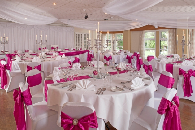 inside of wedding suite with tables and wedding decor