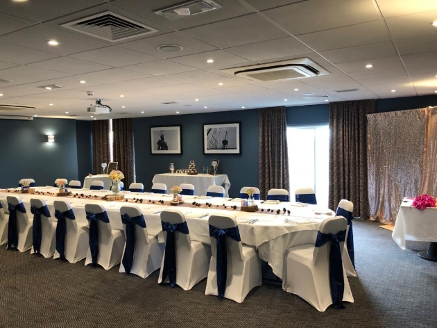 Crowne Plaza Plymouth wedding suite set up with tables and chairs for wedding breakfast